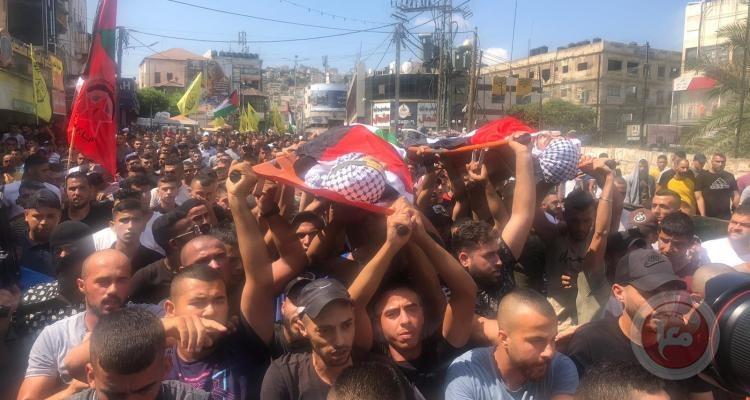 الاحتلال يحتجز جثماني شهيدين- الآلاف يشيعون جثماني شهيدين من شهداء جنين